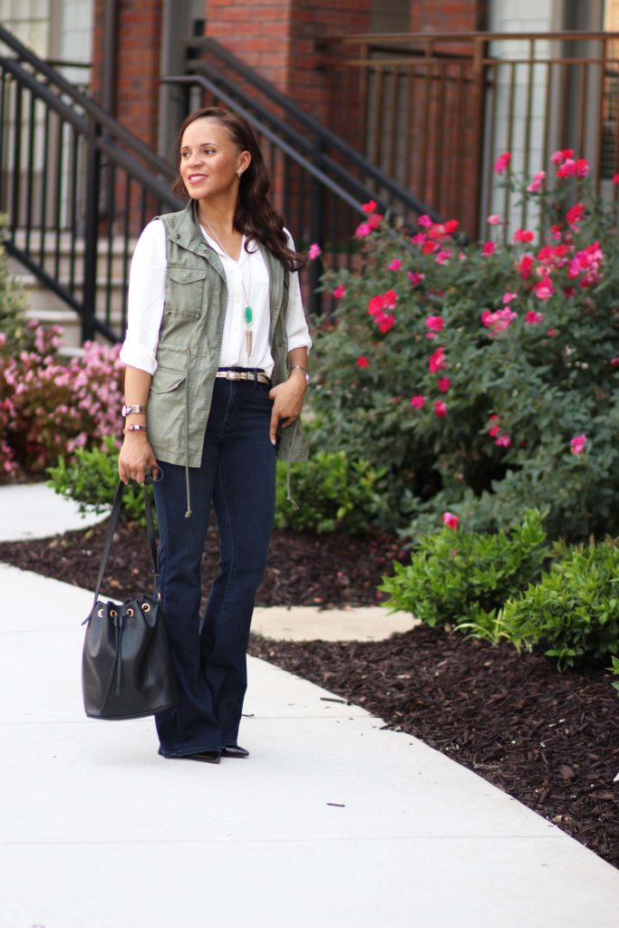 cute fall outfits flare jeans white utility shirt green military vest