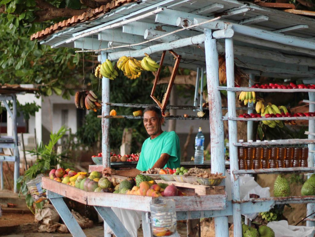what to do in Trinidad Cuba, cuban man selling fruit at fruit stand, trinidad cuba travel guide, 3 days in trinidad cuba