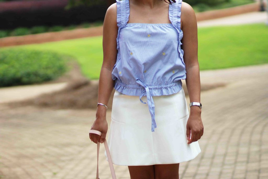 H&M blue and white drawstring top, white jcrew skirt, old navy pink saddle bag, business casual work outfit
