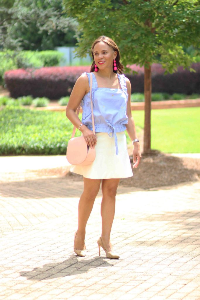 H&M blue and white drawstring top, white jcrew skirt, bauble bar crispin earrings, old navy pink saddle bag, business casual work outfit